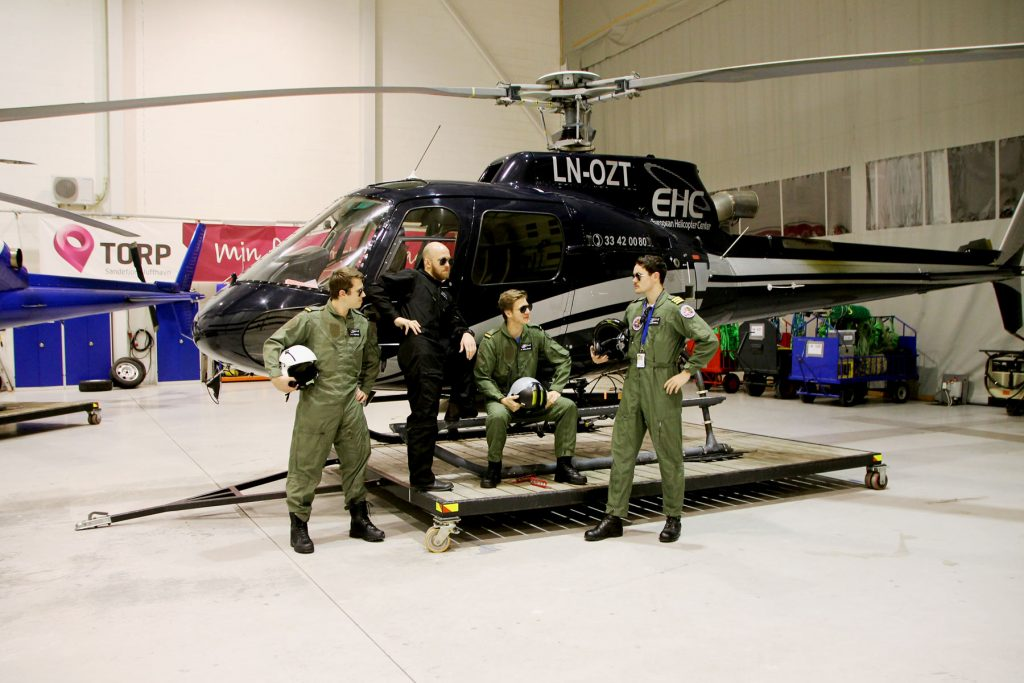 Do we - or do we not have the coolest students ever? Here are four of them, in front of one of our AS350B3, LN-OZT.